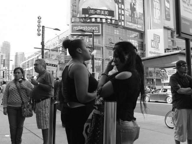Girls hanging out at Yonge and Dundas, Toronto